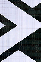 detail of thousand windows of a building with geometric white stripe