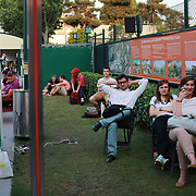 2017 French Open Tennis Tournament - Day Five.  Tennis fans watching the big screen while sitting in a shaded area during the 2017 French Open Tennis Tournament at Roland Garros on June 1st, 2017 in Paris, France.  (Photo by Tim Clayton/Corbis via Getty Images)