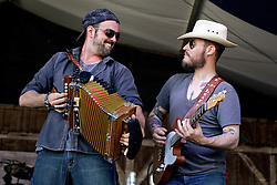 03 May 2015. New Orleans, Louisiana.<br /> The New Orleans Jazz and Heritage Festival. <br /> L/R; Wilson Savoy and John Bertrand of the Pine Leaf Boys plays Fais Do-Do stage.<br /> Photo; Charlie Varley/varleypix.com