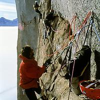 MOUNTAINEERING, ANTARCTICA. Jon Krakauer belays Conrad Anker, high on Rakekniven. Mike Graber films, bkg.  Filchner Mts., Queen Maud Land.