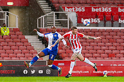 Ryan Nyambe of Blackburn Rovers and James McClean of Stoke City compete in the air - Mandatory by-line: Nick Browning/JMP - 19/12/2020 - FOOTBALL - Bet365 Stadium - Stoke-on-Trent, England - Stoke City v Blackburn Rovers - Sky Bet Championship