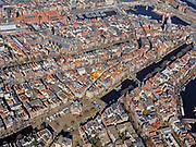 Nederland, Noord-Holland, Amsterdam; 23-03-2020; overzicht binnenstad Amsterdam, Nieuwmarktbuurt. Geldresekade, zicht op de Wallen.<br /> Het publieke leven in het centrum van de hoofdstad is bijna geheel stil komen te liggen als gevolg van het Corona virus. Niet alleen is alle horeca dicht, ook veel winkels en andere bedrijven zijn gesloten. Het publiek blijft over het algemeen binnen, de straten en pleinen zijn stil.<br /> Innercity Amsterdam.<br /> Public life in the center of the capital has come to a complete standstill as a result of the Corona virus. Not only are all pubs, coffee shops and restaurants,  closed, many shops and other companies are also closed. The public generally stays inside, the streets and squares are very quiet.<br /> <br /> luchtfoto (toeslag op standaard tarieven);<br /> aerial photo (additional fee required)<br /> copyright © 2020 foto/photo Siebe Swart