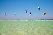 six kite surfers