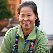 Smiling Lao woman working at Khua Din market in Vientiane