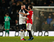 Wayne Rooney of Derby County consoled by Juan Mata of Manchester United during the FA Cup match at the Pride Park Stadium, Derby. Picture date: 5th March 2020. Picture credit should read: Darren Staples/Sportimage