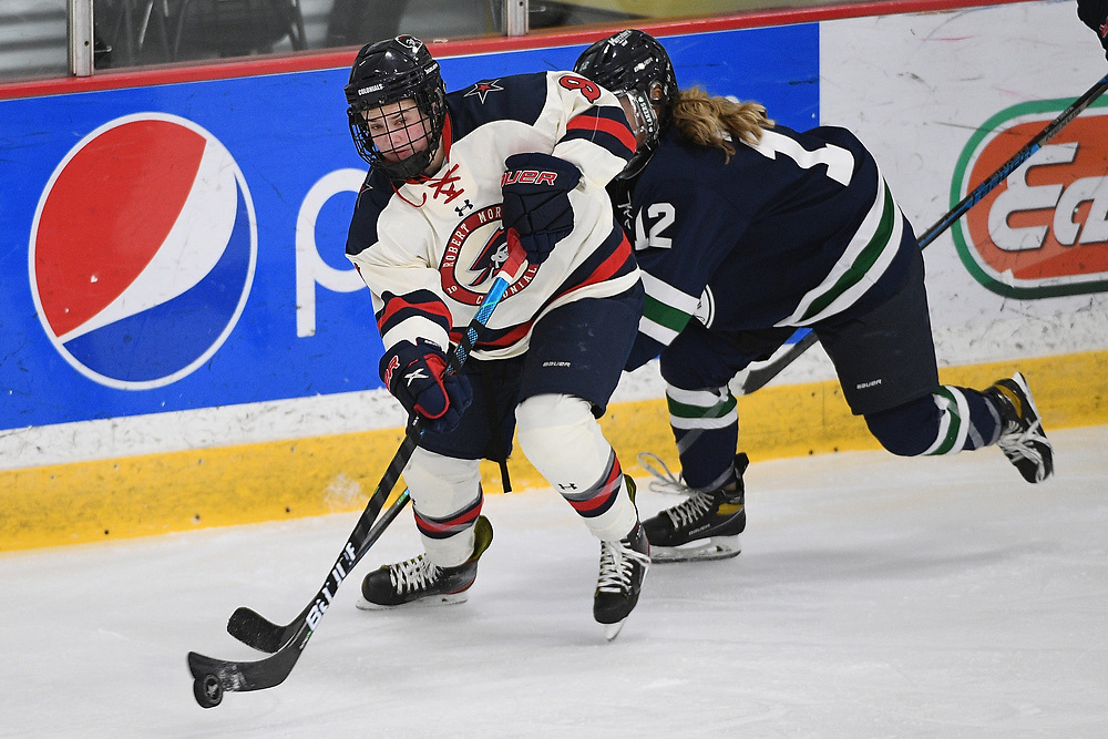 PITTSBURGH, PA - FEBRUARY 09: Maggy Burbidge #9 of the Robert Morris Colonials skates with the puck in the third period during the game against the Mercyhurst Lakers at Clearview Arena on February 09, 2021 in Pittsburgh, Pennsylvania. (Photo by Justin Berl/Robert Morris Athletics)