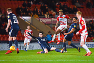 Mallik Wilks of Doncaster Rovers (7) hits a shot from the edge of the box under pressure from Sam Hart of Southend United (42) during the EFL Sky Bet League 1 match between Doncaster Rovers and Southend United at the Keepmoat Stadium, Doncaster, England on 12 February 2019.