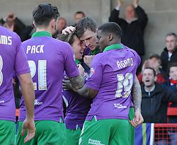Bristol City's Aden Flint celebrates with his team mates after scoring. - Photo mandatory by-line: Dougie Allward/JMP - Mobile: 07966 386802 - 07/03/2015 - SPORT - Football - Crawley - Broadfield Stadium - Crawley Town v Bristol City - Sky Bet League One