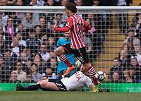 Football - 2016 / 2017 Premier League - Tottenham Hotspur vs. Southampton<br /> <br /> Manolo Gabbiadini of Southampton leaps over the outstretched Jan Vertonghen of Tottenham at White Hart Lane.<br /> <br /> COLORSPORT/DANIEL BEARHAM