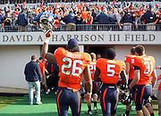 Oct 30, 2010; Charlottesville, VA, USA;  Virginia Cavaliers linebacker Ausar Walcott (26), Virginia Cavaliers running back Torrey Mack (5) and Virginia Cavaliers linebacker Walker Hobby (31) walk off the field after the 24-19 upset win over the Miami Hurricanes at Scott Stadium. Mandatory Credit: Andrew Shurtleff