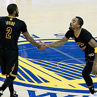 12 June 2017: Cleveland Cavaliers guard Kyrie Irving (2) celebrates with Cleveland Cavaliers guard JR Smith (5) during the Golden State Warriors 129-120 victory over the Cleveland Cavaliers, in game 5 of the 2017 NBA Finals, at the Oracle Arena, Oakland, California, USA.