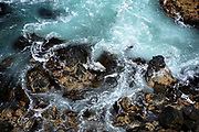 Rocks and water patterns viewed from above at a lighthouse