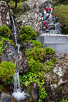 """Vertical Garden at Konomineji - Temple 27 Konomineji is situated a long days walk - about 28 kilometers - from the previous temple, Kongochoji.  Konomineji is situated at 424 meters above sea level on the upper slope of Konomine Peak.  A section of the footpath leading to it is very steep, so the temple is called a Nansho Temple, meaning that it is hard to reach. It is one of the most difficult climbs in the entire pilgrimage, the path leading to the temple continues for more than a kilometre at a slope of 45 degrees. It is also classed as asekisho, a kind of """"spiritual checkpoint"""" where your motives are examinedand if found wanting pilgrims would be unable to carry on with the pilgrimage. Konomineji was founded in the early 8thcentury by Gyoki who is credited with founding quite a few of the temples on the Shikoku Pilgrimage, about a century later Kobo Daishi visited and expanded the temple.  On the temple's slopes is a beautifully sculpted vertical garden."""