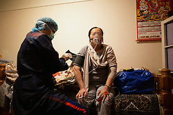 The patient is on oxygen bottle with a respirator. Orane and Nicolas, members of the Protection Civile wearing personal protection equipment (PPE) in Paris takes care of a asian women suspected of being infected by the coronavirus during an intervention. French first aid workers from the Protection Civile Paris Nicolas, Orane and Quentin takes care of Covid cases at their home as they are doing a guard by night to help the SAMU, They handle cases suspected being infected with the novel coronavirus at their home. Paris on April 19, 2020 during a lockdown in France to stop the spread of the COVID-19. France has been on lockdown since March 17 in a bid to limit the contagion caused by the novel coronavirus. Photo by Raphael Lafargue/ABACAPRESS.COM