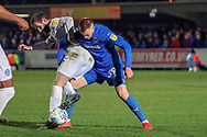 AFC Wimbledon striker Joe Pigott (39) battles for possession during the EFL Sky Bet League 1 match between AFC Wimbledon and Peterborough United at the Cherry Red Records Stadium, Kingston, England on 12 March 2019.