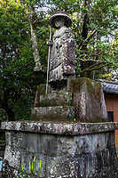 """Kobo Daishi Statue at Sekkeiji - Temple 33 on the Shikoku Pilgrimage and can be translated as, """"Snowy Cliff Temple"""". This temple is one of only three Zen temples on the Shikoku Pilgrimage. Legend has it that this place was home to a long-suffering ghost who woke up the monk, Geppou, saying """"Even the water is weary of living.""""  Geppou spoke to the apparition who was attempting to recall a poem from which these lines come. Once the poem was completed, the ghost disappeared having now been relieved of trying to recall the missing lines. In the 16th century it changed to a Rinzai Zen temple, now one of only three Zen temples on the pilgrimage."""