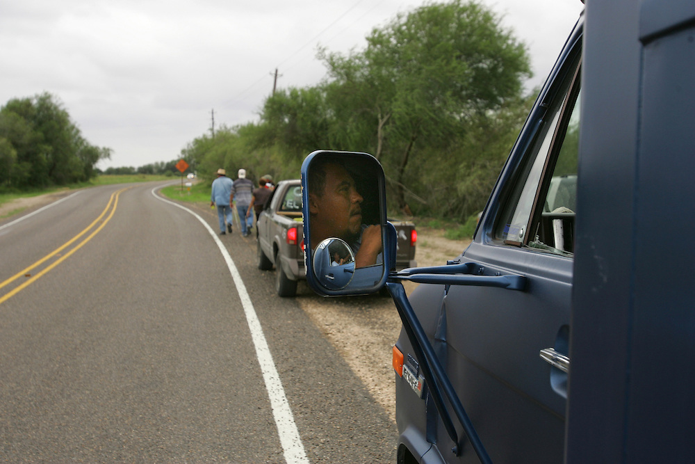 Alejandro Sedano (seen in rearview mirror) joined Jay Johnson Castro's walk on day 15.  Sedano's wife lost both her legs when she was hit by a train while trying to pass an immigration checkpoint last year.  Sedano is working to support her, but faces a deportation hearing in less than a week.
