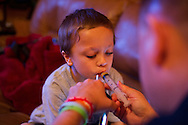 Xavier Mascareñas/Treasure Coast Newspapers; Seven-year-old Brandon Cooper, who was diagnosed in June with chronic myeloid leukemia, controls the amount of Gleevec he ingests as his father, Todd Cooper, dispenses the chemotherapy drug via oral syringe at home in Stuart on Thursday, Sept. 25, 2014.