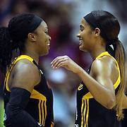 Odyssey Sims, (left) and Skylar Diggins, Tulsa Shock, embrace during the Connecticut Sun Vs Tulsa Shock WNBA regular season game at Mohegan Sun Arena, Uncasville, Connecticut, USA. 3rd July 2014. Photo Tim Clayton