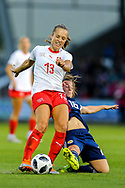 Christie Murray (#16) of Scotland slides in to win the ball from Lia Walti (#13) of Switzerland during the 2019 FIFA Women's World Cup UEFA Qualifier match between Scotland Women and Switzerland at the Simple Digital Arena, St Mirren, Scotland on 30 August 2018.