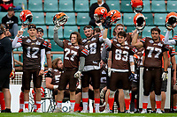 KELOWNA, BC - SEPTEMBER 8:  The Okanagan Sun raise helmets at teh side lines to cheer on teammates against the Langley Rams at the Apple Bowl on September 8, 2019 in Kelowna, Canada. (Photo by Marissa Baecker/Shoot the Breeze)
