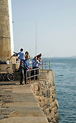 Fishermen at the end of the pier, St Peter Port, Guernsey, Channel Islands, UK