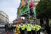 Climate Change protesters blockade Trafalgar Square on 7th October, 2019 in London, Untited Kingdom. Extinction Rebellion plan to occupy 12 sites situated around key Government locations around Westminster for two weeks to protest against climate change.