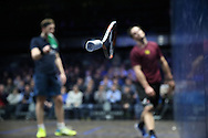 Paul Coll of New Zealand (wearing a Maroon shirt) throws his squash racket  in frustration after he loses the match against James Willstrop of England (blue shirt)  . Canary Wharf Squash Classic 2016 , day two at the East Wintergarden in Canary Wharf , London on Tuesday 8th March 2016.<br /> pic by John Patrick Fletcher, Andrew Orchard sports photography.