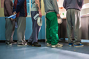 Prisoners line up at the canteen for lunch.  Beaufort House, a skill development unit for enhanced prisoners. Part of HMP/YOI Portland, a resettlement prison with a capacity for 530 prisoners.Dorset, United Kingdom.