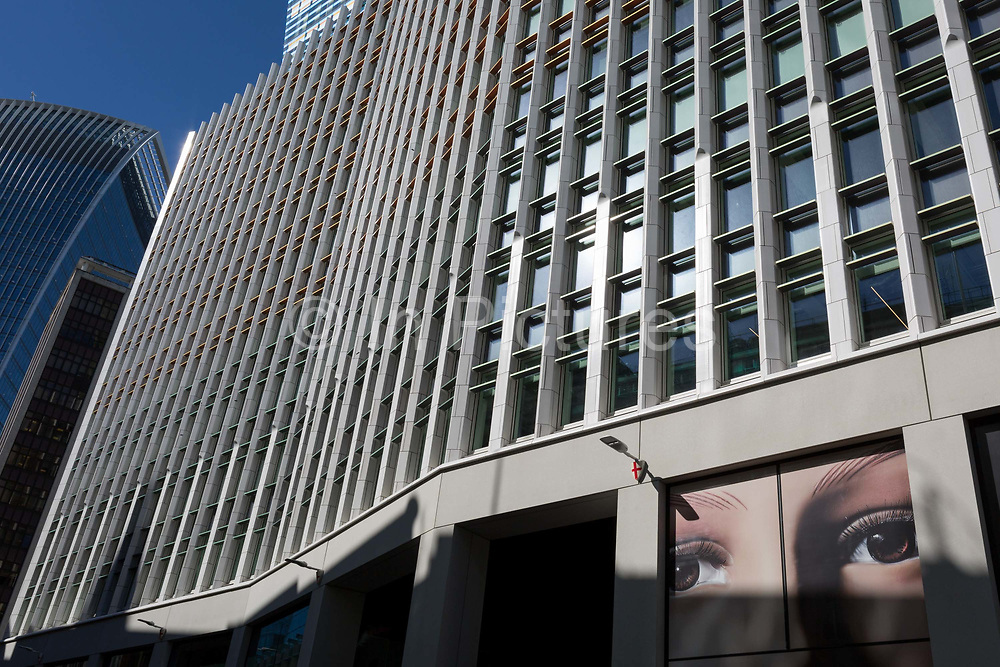 A pair of eyes and surrounding City of London offices on Fenchurch Street - in the heart of the capitals financial district aka The Square Mile, on 24th September 2018, in London, England.