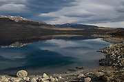 Sarmiento lake or Lago Sarmiento<br /> Calcium deposits around edge possibly from hydrothermal activity<br /> Torres del Paine National Park<br /> Patagonia<br /> Magellanic region of Southern Chile