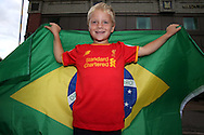 a  young Liverpool fan posing with a Brazil flag. Premier league match, Chelsea v Liverpool at Stamford Bridge in London on Friday 16th September 2016.<br /> pic by John Patrick Fletcher, Andrew Orchard sports photography.