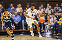 Dec 1, 2019; Morgantown, WV, USA; West Virginia Mountaineers guard Miles McBride (4) dribbles past Rhode Island Rams guard Fatts Russell (1) during the second half at WVU Coliseum. Mandatory Credit: Ben Queen-USA TODAY Sports