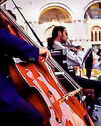 A quartet of musicians perform near St. Marks Cathedral in Venice, Italy