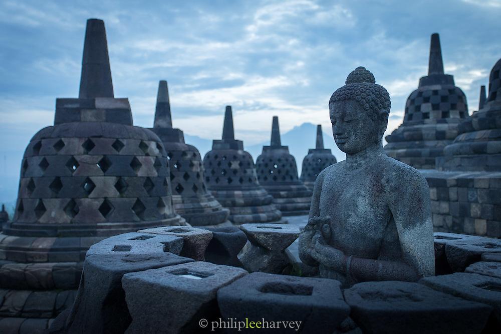 Statue of Buddha, Borobudur, Kedu Valley, South Central Java, Java, Indonesia, Southeast Asia