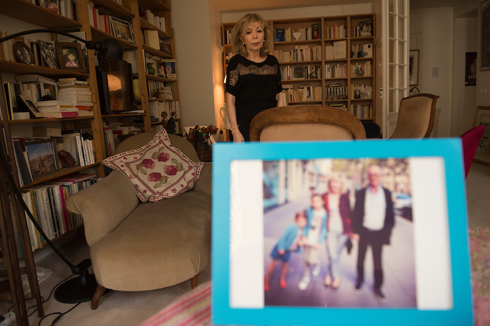 March 6, 2015, Paris, France. Maryse Wolinski  (1943, Algiers) in her appartment in Paris. On the forground one of the last photos of Georges Wolinski before he was assasinated, shown here with his wife Maryse Wolinski (a writer) and their grand children. Georges Wolinski and Maryse Wolinski were married and had lived for 47 years together. Two month after the death of Georges Wolinski, the apartment is full of souvenirs and notes, attesting a half-century-long love affair. Georges Wolinski was 80 years old when he was murdered by 2 French jihadists, he was one of the 12 victims of the massacre in the Charlie Hebdo offices on January 7, 2015 in Paris. Charlie Hebdo published caricatures of Mohammed, considered blasphemous by some Muslims. During his life, Georges Wolinski defended freedom, secularism and humour and was one of the major political cartoonists in France. Photo: Steven Wassenaar.