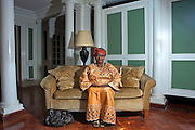 This image is part of a set of portraits taken of members of staff from Muthaiga Country Club who have worked for more than 25 years in the establishment. Born 20 June 1949 in Ngong Town in Kajiado now aged 62, Mingina Rapasi or ?Rose? as she became know joined the Muthaiga Club on 15th Sept 1978 and retired in 2002. The Club built to give out of town farmers a Nairobi base during Kenya's colonial period. This was the first time she had worked for a 'club' and for a 'mzungu' (white) people and some of the members found it a bit difficult as it was a new experience for them having a black secretary. At the beginning there were no computers, only electric typewriters. ?I hated working with a dictofone machine, Mrs Wilson used to come in saying things like 'only 2 tapes for you to type up today Rose don't worry!'?  June 2011