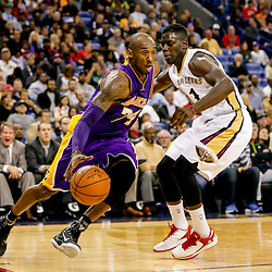 Nov 12, 2014; New Orleans, LA, USA; Los Angeles Lakers guard Kobe Bryant (24) drives past New Orleans Pelicans guard Jrue Holiday (11) during the second half of a game at the Smoothie King Center. The Pelicans defeated the Lakers 109-102. Mandatory Credit: Derick E. Hingle-USA TODAY Sports