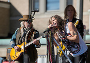 05 November 2012:  Aerosmith's  Brad Whitford, Tom Hamilton and Steven Tyler perform a free concert in Boston's Allston neighborhood in front of the apartment building, 1325 Commonwealth Ave, which was the band's home in the early 1970's.  Boston, MA. ***Editorial Use Only*****