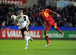 Marko Janko (Trabzonspor) of Austria  battles for the high ball with Ashley Williams (Swansea City) of Wales  - Photo mandatory by-line: Joe Meredith/JMP - Tel: Mobile: 07966 386802 06/02/2013 - SPORT - FOOTBALL - Liberty Stadium - Swansea  -  Wales V Austria - International Friendly
