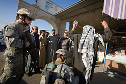 Members of the 1st Infantry, 17th Regiment, help Iraqi forces patrol in western Mosul, Iraq, Dec. 11, 2005. This is part of an effort to provide security in preparation for Iraq's first post-Saddam parliamentary elections. The western sector is home to Mosul's primarily Sunni population, which has been resistant to the American presence in Iraq.
