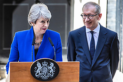 © Licensed to London News Pictures. 24/07/2019. London, UK. Prime Minister Theresa May (L) delivers a speech with her husband Philip May (R) by her side, as she leaves Downing Street. Boris Johnson will become the next Prime Minister this afternoon. Photo credit: Rob Pinney/LNP