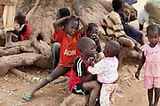 Children are sitting around Bagega, pop. 9000, a large village affected by lead poisoning due to the unsafe techniques employed for extracting gold, in Zamfara State, Nigeria. It is mainly caused by ingestion and breathing of lead particles released in the steps to isolate the gold from other metals. This type of lead is soluble in stomach acid and children under-5 are most affected, as they tend to ingest more through their hands by touching the ground, and are developing symptoms often leading to death or serious disabilities.
