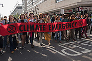 Extinction Rebellion climate change protest on 18th April 2019 in London, United Kingdom. Protesters occupy major London traffic arteries to call on the governemnt to act on the climate and environmental disaster. Extinction Rebellion is a socio-political movement which intends to utilise nonviolent resistance to avert climate breakdown, halt biodiversity loss, and minimise the risk of human extinction and ecological collapse.