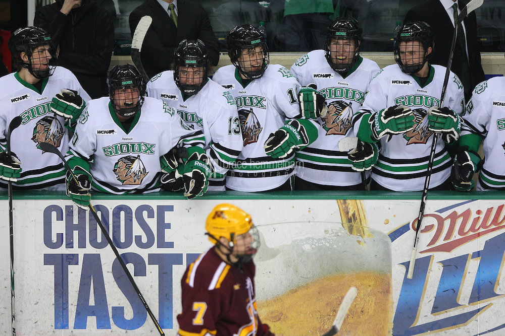 13 January 2012: North Dakota Fighting Sioux bench celebrates a goal against Minnesota Golden Gophers at Ralph Engelstad Arena in Grand Forks, ND. North Dakota defeated Minnesota 2-1.