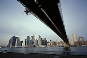 Under the Brooklyn Bridge with downtown Manhattan in the background.