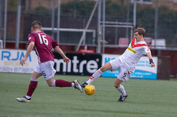 Stenhousemuir's Sean Dickson and Airdrie's Kieran Millar. half time : Stenhousemuir 0 v 0 Airdrie, Scottish Football League Division One played 26/1/2019 at Ochilview Park.