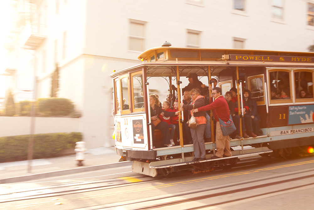 San Francisco, California, United States - Tourists on traditional Cable car at Russian Hill Neighborhood.