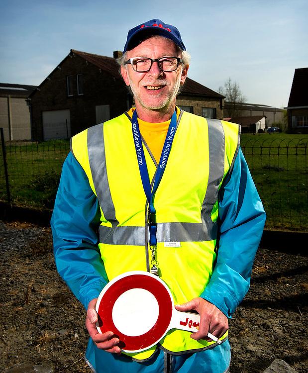 Belgie, Vlaanderen, Westhoek, 02-04-2014.<br /> Wielrennen, Elite Mannen, 3-daagse van de Panne.<br /> Signaalgevers bij de wielerkoers 3-Daagse van de Panne.<br /> <br /> Naam : José Ryckebosch, 8 jaar actief als signaalgever.<br /> <br /> Foto: Klaas Jan van der Weij