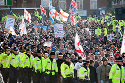 © under licence to London News Pictures 27/11/2010 today picture.The English Defence League held a National protest march through Nuneaton, Warwickshire earlier today. Police from forces as far away as Gloucestershire were called upon to contain the massed ranks of demonstraters. Protesters make their way alomg the ring road past the Justice centre..Picture credit: Dave Warren/London News Pictures...